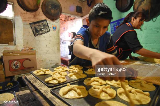 Child seen molding the dough during a process of the manufacturing of Bread of the Dead as part of the Pan de Muerto manufacturing on October 30 2018...