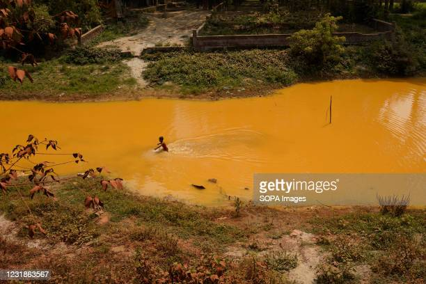 Child seen playing in a canal which is polluted by wastewater from a Water treatment plant at Savar in Dhaka. In 2019 Bangladesh government opened a...