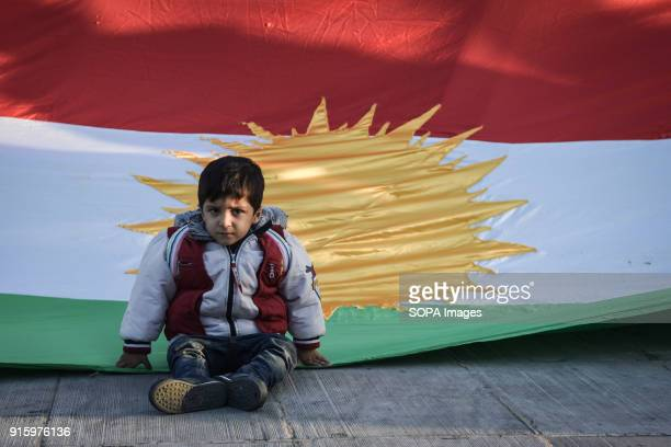 A child seen sitting front of a large Kurdistan flag during the demonstration Kurds living in Athens marched toward the Turkish embassy the protest...
