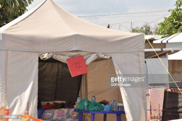 Child seen sleeping in an isolation tent receiving suspicious cases at the Ebola treatment center of the NGO ALIMA. The child was among principal...