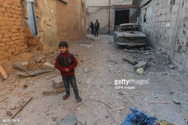 A child seen standing next to his bombed housewhich killed his sister who was sitting inside the house The town of Douma in the outskirt of Damascus...