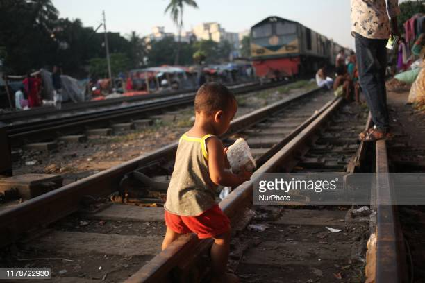 A child seen walking on a railway track in Dhaka Bangladesh on 29 October 2019