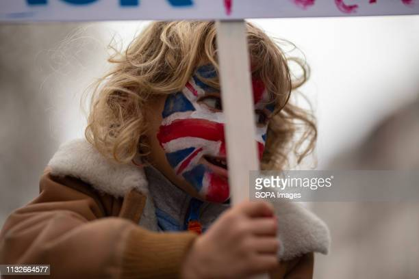 A child seen with his face painted as the British flag during the protest Hundreds of people gathered at the centre of London for the People's Vote...