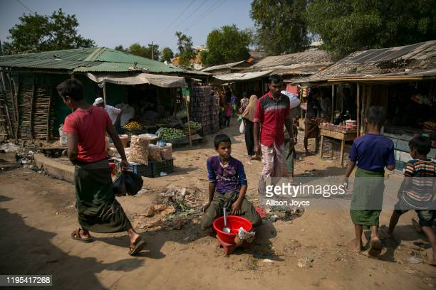 Child sells snacks on the road in a Rohingya refugee camp on January 23, 2020 in Cox's Bazar, Bangladesh. On Thursday, the International Court of...