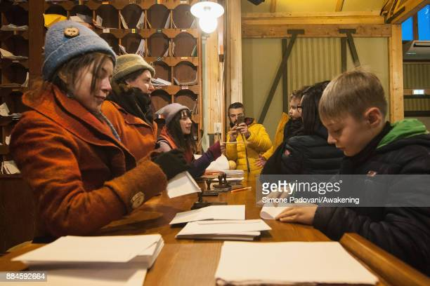 A child sends a Christmas letter in the house of Santa Claus in the Reggia of Venaria on December 2 2017 in Turin Italy