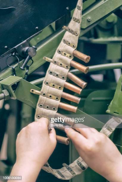 child serving the machine gun with cartridges - child soldiers stockfoto's en -beelden