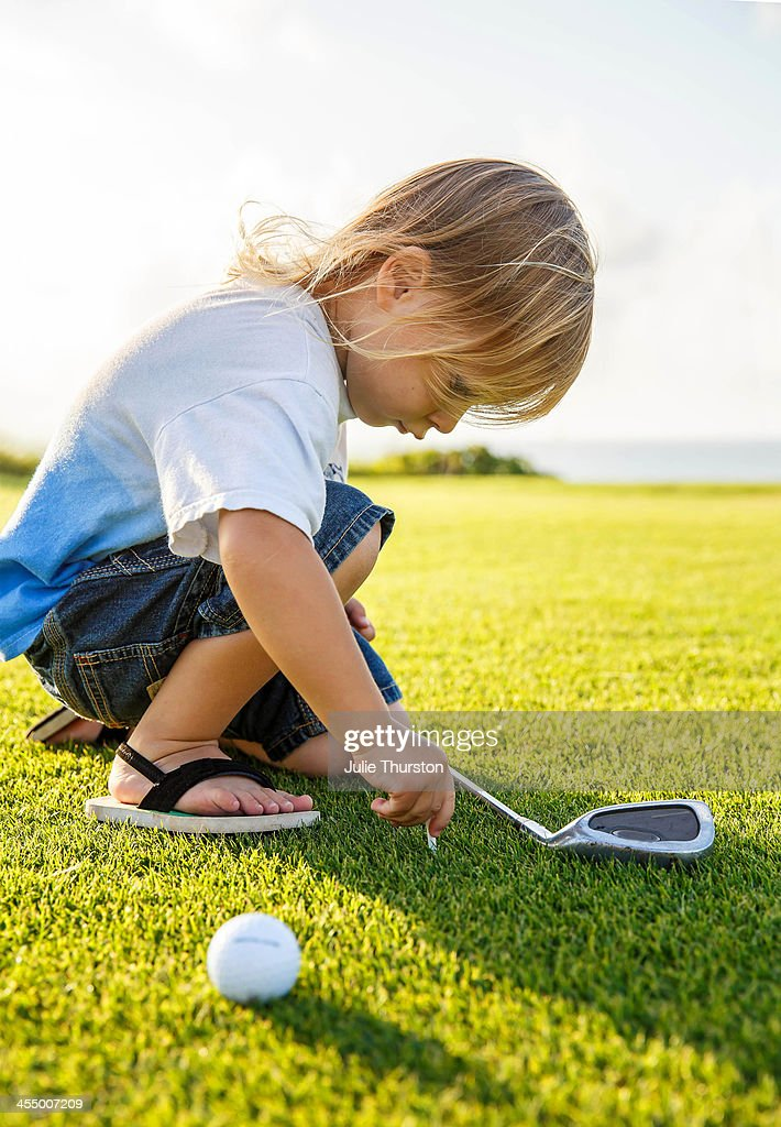Child Setting His Tee at the Golf Course, Hawaii : Stock Photo
