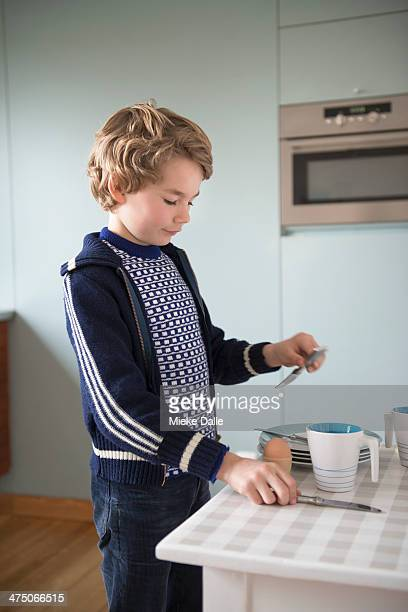 Child setting the breakfast table