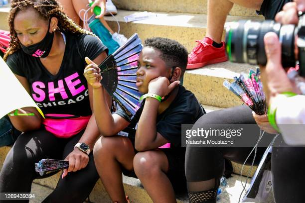 Child shades himself from the sun on the steps of the Lincoln Memorial during the Commitment March on August 28, 2020 in Washington, DC. Rev. Al...