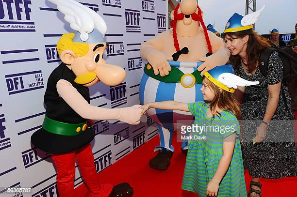 A child shakes the hand of Asterix at the Asterix and Obelix 3D Premiere during the 2012 Doha Tribeca Film Festival at o n November 23 2012 in Doha...