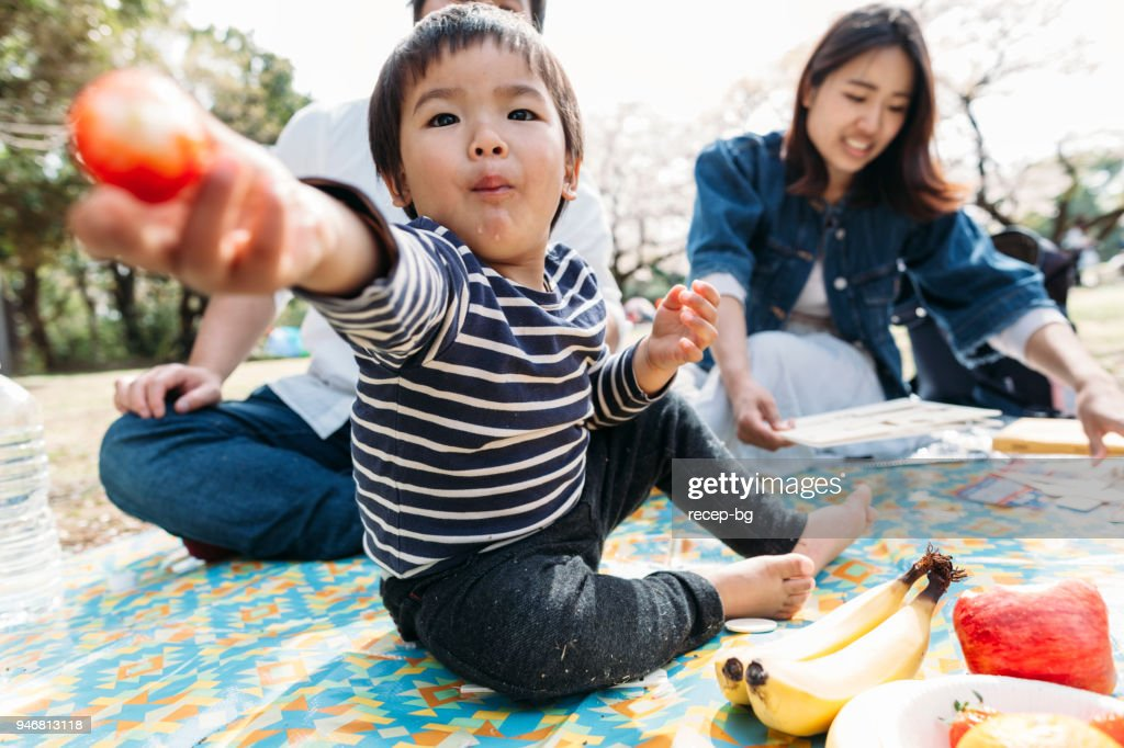 Child sharing his food : Stock Photo