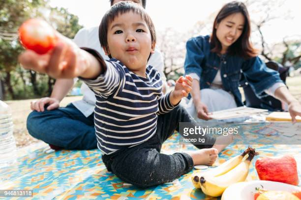 child sharing his food - sharing stock pictures, royalty-free photos & images