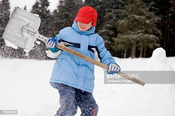 Child shoveling snow