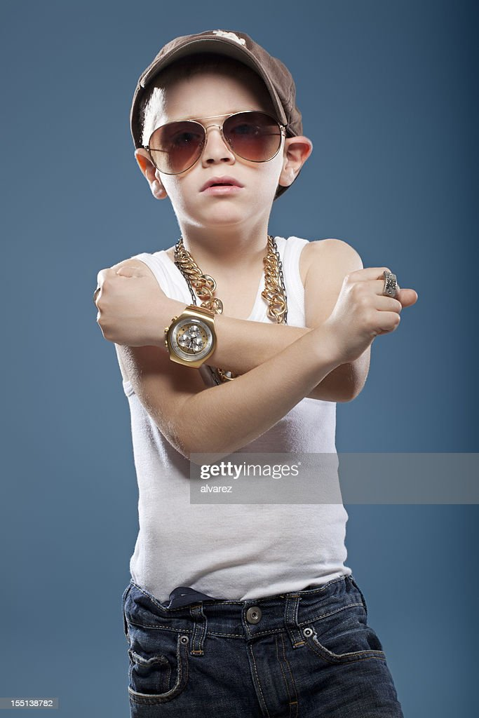 Child showing his muscles : Stock Photo