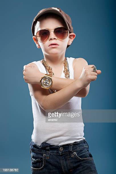 child showing his muscles - gangster stock pictures, royalty-free photos & images