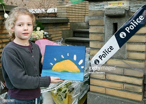 A child shows a painting she made at the entrance of the house of the Mokadem family at the General Jaques Avenue March 2 2007 in Nivelles Belgium...