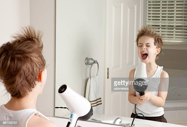 A Child Singing Into A Hair Dryer