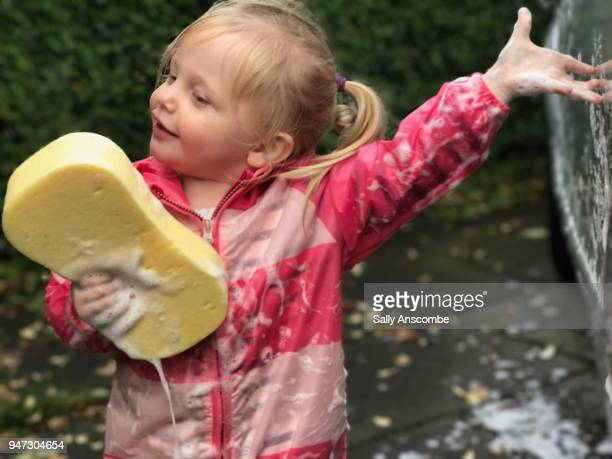 Child singing into a sponge