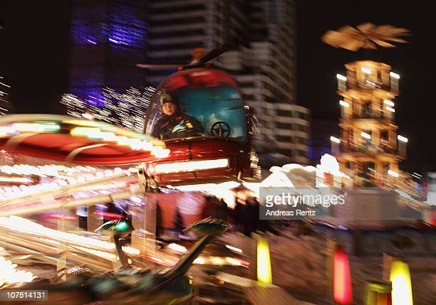 A child sits in a helicopter carousel at the Christmas market at the Kaiser Wilhelm Memorial Church on Dezember 10 2010 in Berlin Germany Christmas...