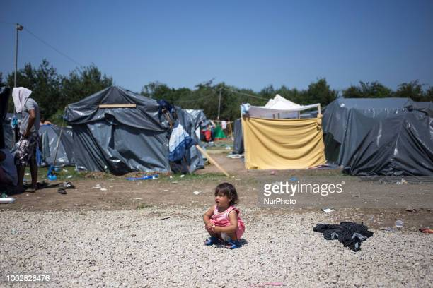 Child sits in the middle of the camp in Refugee camp in Velika Kladusa BiH on July 20 2018