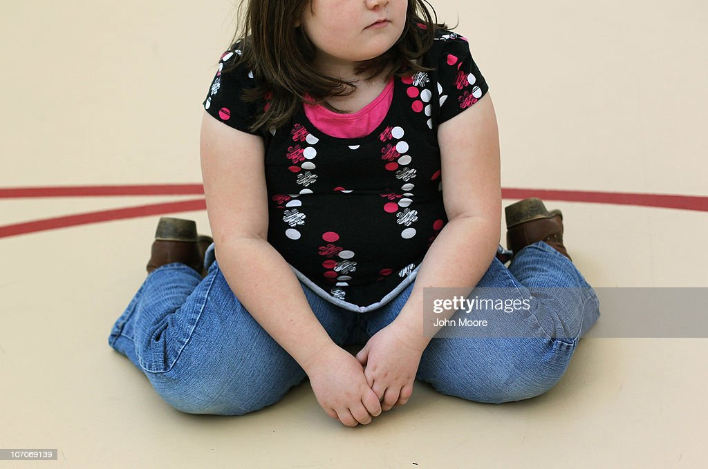 A child sits on the gym floor during the Shapedown program for overweight adolescents and children on November 13, 2010 in Aurora, Colorado. The 10-week family-centered program held by the Denver area Children's Hospital teaches youth and their parents ways to lead a healthier more active lifestyle, as a longer lasting weight-loss alternative to dieting. Nationally, some 15 percent of children are overweight or obese, as are some 60 percent of adults.