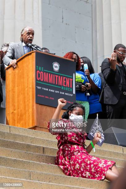 Child sits on the steps of the Lincoln Memorial while Al Sharpton speaks during the Commitment March on August 28, 2020 in Washington, DC. Rev. Al...