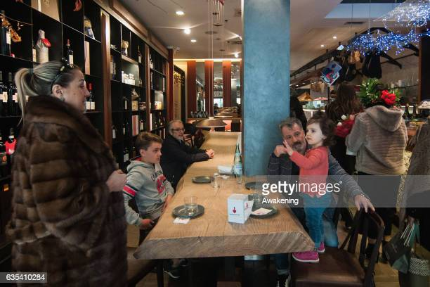 Child sits with her parents for lunch at a table in the Antonio Ferrari restaurant on February 15, 2017 in Padova, Italy. The restaurant offers a 5%...