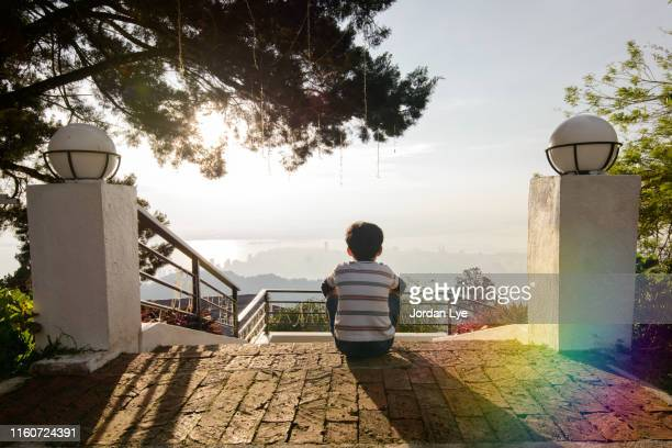 Child sitting and enjoy the view in front of him