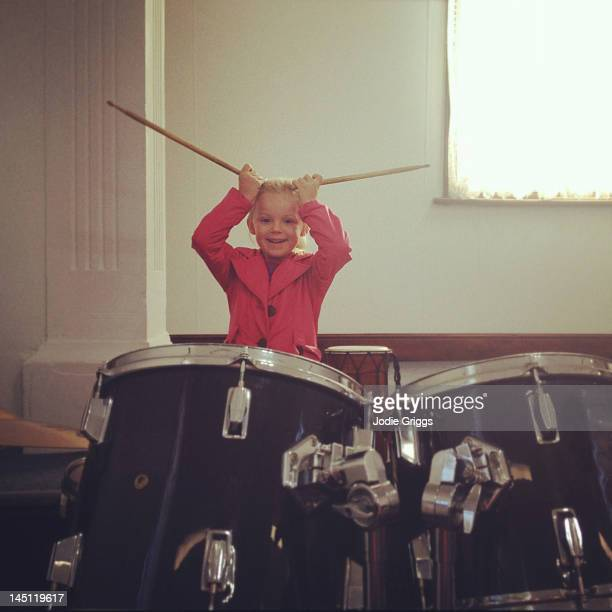 Child sitting at drums