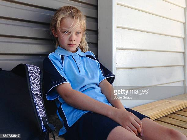 Child sitting down after coming home from school