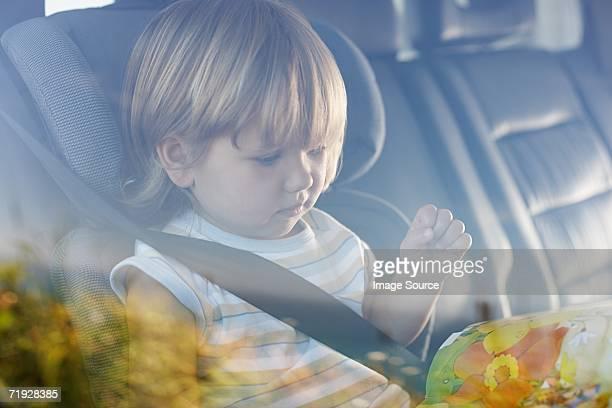 Child sitting in car
