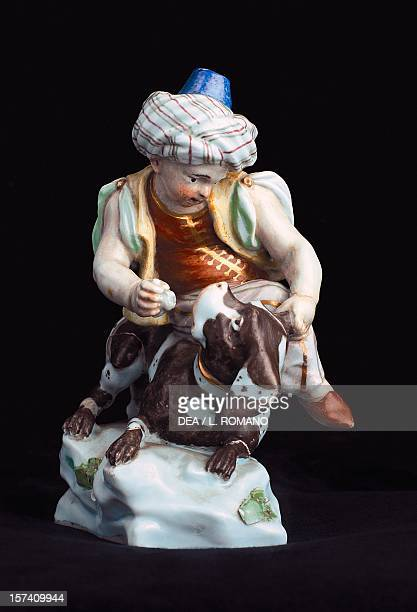 Child sitting on piebald dog 17451750 by Giuseppe Gricci ceramic Capodimonte manufacture Naples Italy 18th century Naples Museo Nazionale Di...