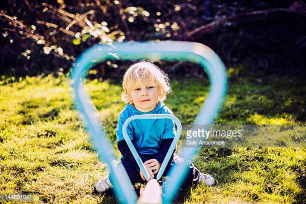 Child sitting on seesaw