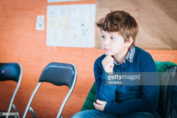 Child sitting with a funny pose