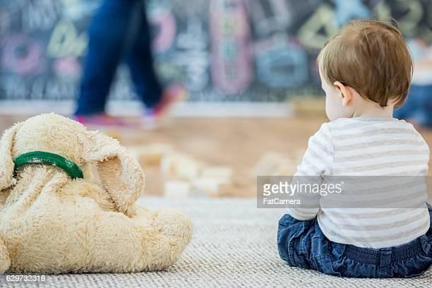 Child Sitting with a Stuffed Animal