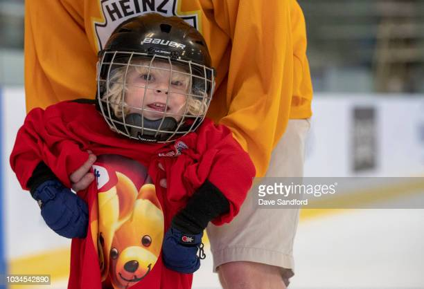 A child skates with some assistance in the free skate during Kraft Hockeyville Canada on September 16 2018 at the Lucan Community Memorial Centre in...