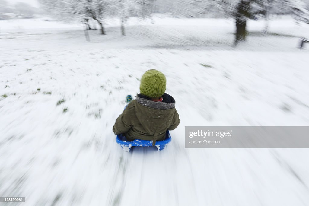 Child Sledging. : Stock Photo
