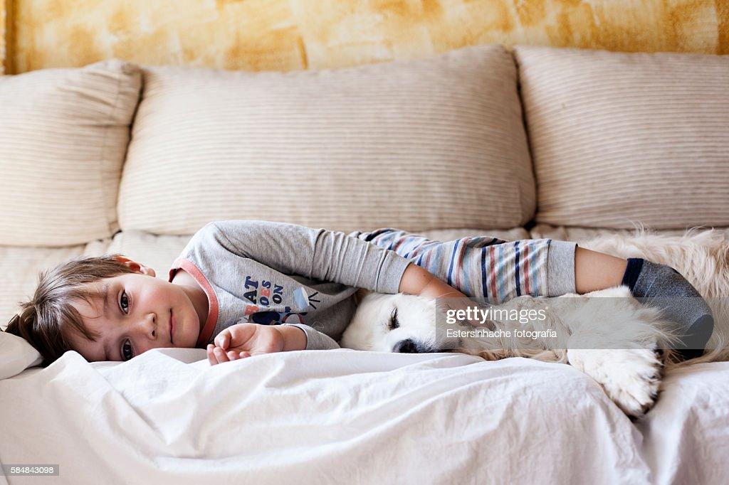 Child sleeping with his dog : Stock Photo