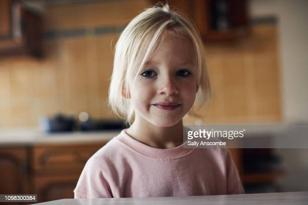 Child smiling looking at the camera