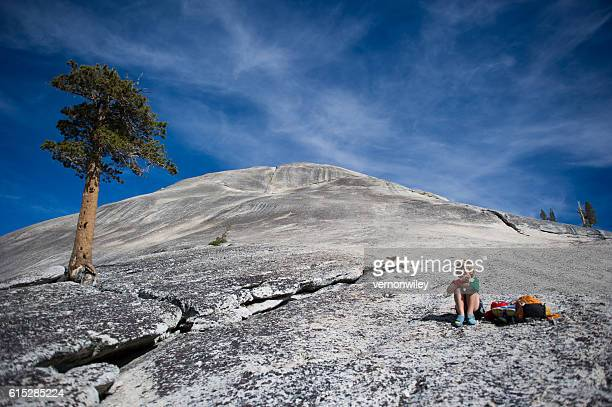 Child snacking on dome in Yosemite Valley, Ca