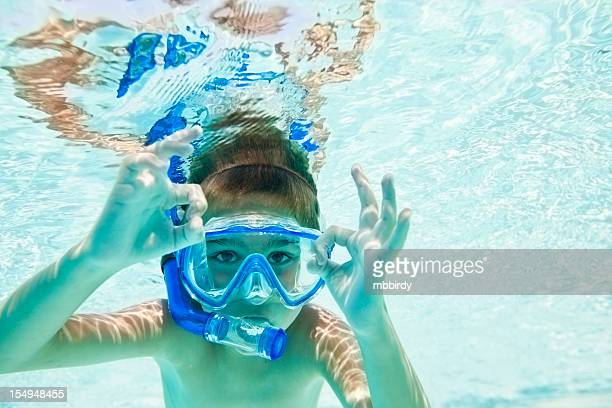 Child snorkeling in swimming pool