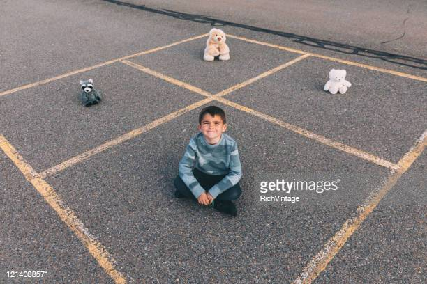 child social distancing inside the box - good; times bad times stock pictures, royalty-free photos & images