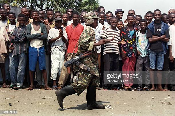 A child soldier from the LaurentDesire Kabila's rebel troops of the Alliance of Democratic Forces for the Liberation of CongoZaire patrols in...