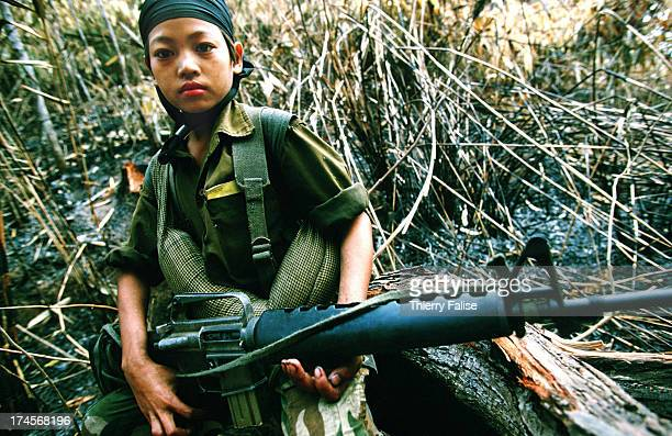 Child soldier in Kamerplaw, southern Burma - headquarters of God's Army. God's Army is a tiny breakaway faction of the Christian Karen National...