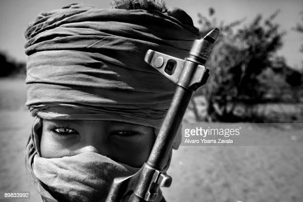 A child soldier member of the SLA guerrillas one of the rebel groups fighting against the Sudanese goverment in Khartoum