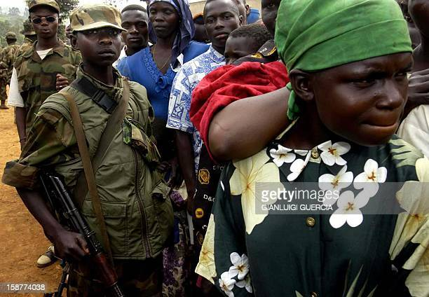 child soldier patrols 05 June 2003 in IgaBarriere some 25 km north of Bunia in the Ituri province during a rally held by UPC leader Thomas Lubanga...