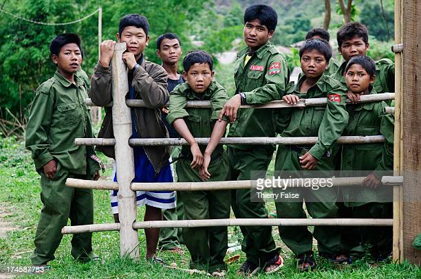 Child soldiers from the United Wa State Army 171 Division in a village in the socalled Southern Wa State The 171 Division is run by the Chinese Wa...
