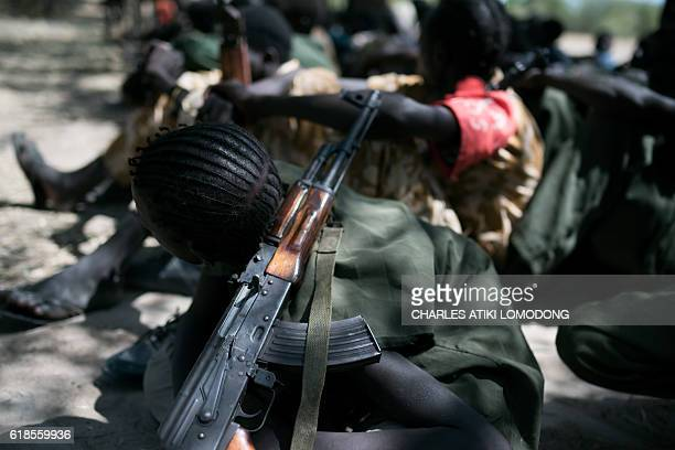 TOPSHOT Child soldiers listen to a speech after being released from a group called the Cobra Faction and from the main SPLA/IO rebel faction during a...