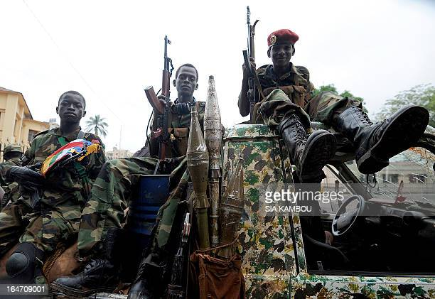 Child soldiers of the Seleka coalition sits on a pickup truck near the Presidential palace in Bangui on March 25 2013 Seleka coalition rebels seized...