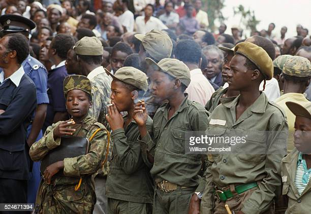 Child soldiers watch the inauguration of Yoweri Museveni, National Resistance Army leader who overthrew Ugandan President Milton Obote, and became...